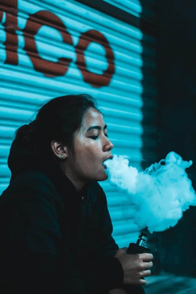woman in black shirt vaping